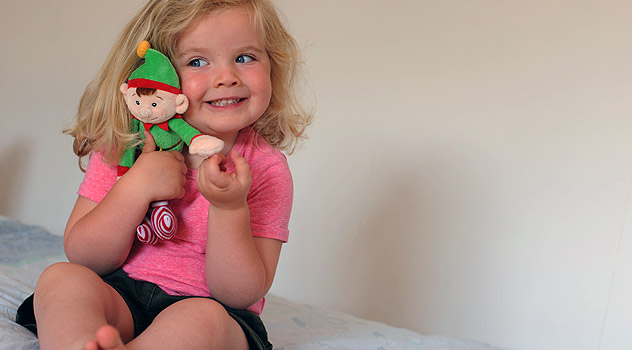 Child with Christmas Elf in Summer